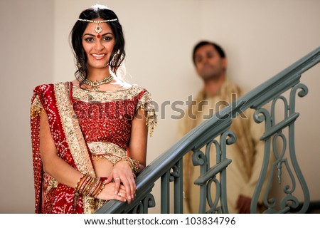Gorgeous Indian bride and groom traditionally dressed