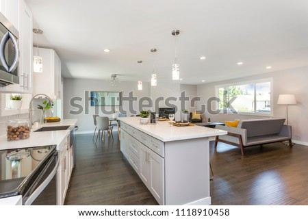 Gorgeous kitchen with open concept floorplan, white cabinets and huge island. #1118910458