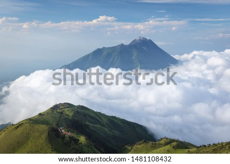 Gorgeous landscape of Mount Merbabu with Mount Merapi on the background. Mount Merbabu is one of the favorite climbing destinations and is very popular among travelers. #1481108432