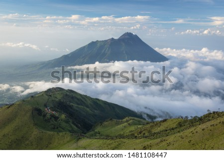Gorgeous landscape of Mount Merbabu with Mount Merapi on the background. Mount Merbabu is one of the favorite climbing destinations and is very popular among travelers. #1481108447