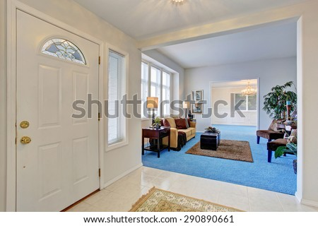 Gorgeous living room with bright blue carpet and nice decor.