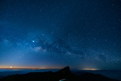 Gorgeous milky way, moon and sun in starry sky with the light of dawn at Doi Mon Jong, Chiangmai, Thailand