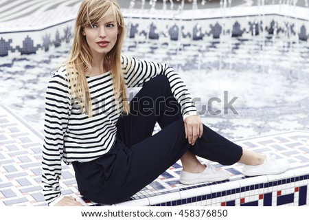 Gorgeous model in striped top, looking away