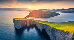 Gorgeous morning view from flying drone of Sorvagsvatn lake, Vagar, Faroe Islands, Denmark, Europe. Perfect summer sunrise on Atlantic Ocean. Beauty of nature concept background.