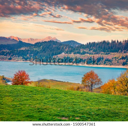Gorgeous morning view of Roselend lake/Lac de Roselend. Majestic autumn scene of Auvergne-Rhone-Alpes, France, Europe. Beauty of nature concept background. #1500547361