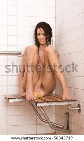 Gorgeous nude female in shower - stock photo