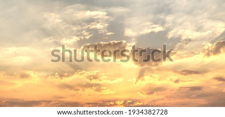 Gorgeous panorama scenic of the sunrise or sunset with silver lining and cloud on the orange sky