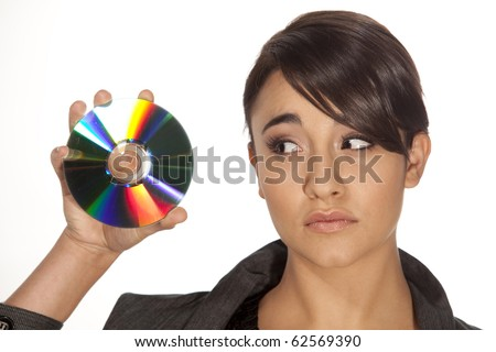 Gorgeous professional looking woman holding up a cd on white background.