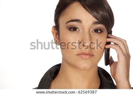 Gorgeous professional woman answering her mobile phone on white background. - stock photo