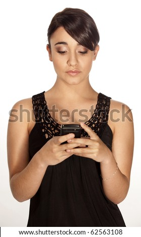 Gorgeous professional woman typing a text sms message on her mobile phone on a white background.