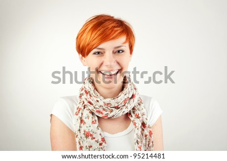gorgeous red-hair girl smiling cheerfully