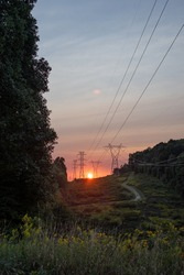 Gorgeous red sun during sunset on the powerlines.