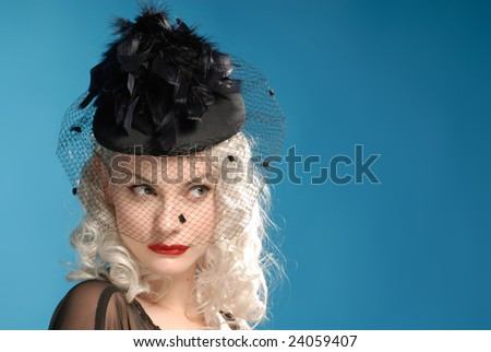 gorgeous retro girl in authentic forties black hat - space for copy text