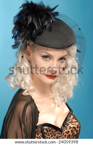 gorgeous retro girl in authentic forties black hat with feathers