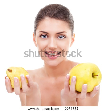 Gorgeous smiling young woman holding an apple and a pear over white background