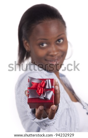 Gorgeous South African woman holding a gift box.