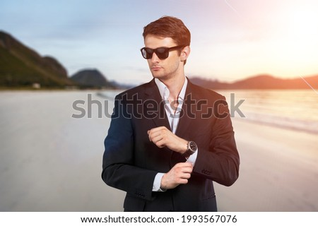 Gorgeous stylish young man wearing a fashionable shirt and suit. City style.