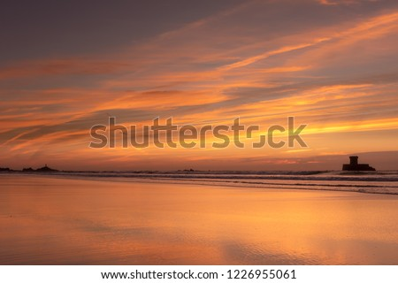 Gorgeous sunset reflections at St Ouens Bay, Jersey, Channel Islands