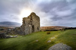 Gorgeous sunset view of the crumbling ruins of Dolwyddelan Castle in Snowdonia National Park, Wales UK.