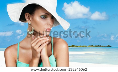 Gorgeous tanned woman on summer vacation