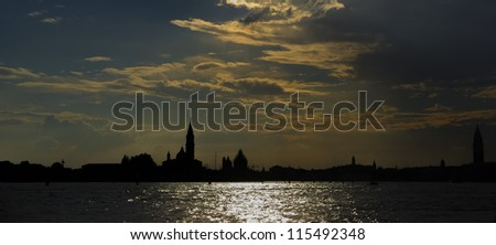 Gorgeous venetian sunset, panorama from the water, Venice, Italy