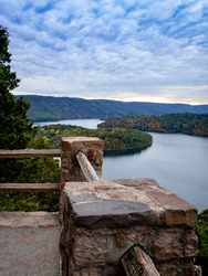 Gorgeous view of Raystown Lake from Hawn's Overlook near Altoona, Pennsylvania in the fall right before sunset with a view of the dramatic blue sky filled with clouds and pops of pink with foliage.