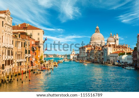 Gorgeous view of the Grand Canal and Basilica Santa Maria della Salute during sunset with interesting clouds, Venice, Italy #115516789