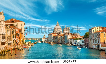 Gorgeous view of the Grand Canal and Basilica Santa Maria della Salute during sunset with interesting clouds, Venice, Italy #129236771