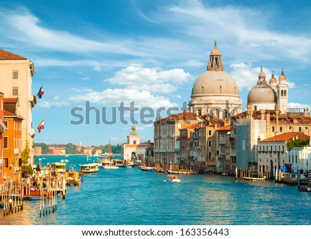 Gorgeous view of the Grand Canal and Basilica Santa Maria della Salute during sunset with interesting clouds, Venice, Italy #163356443