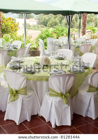 gorgeous wedding chair and table setting for fine dining at outdoors - stock photo