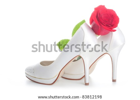 stock photo Gorgeous wedding shoes white with a red rose isolated on a