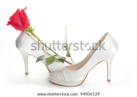Gorgeous wedding shoes white with a red rose isolated on a white background