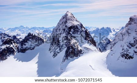 gorgeous winter mountain landscape in the Swiss Alps with the famous summit of Piz Buin in the center