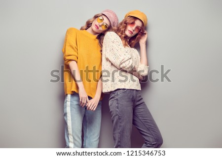 ddbde1f9f302 Gorgeous Woman in street Autumn Outfit. Portrait Two Girl posing in Studio. Young  Playful