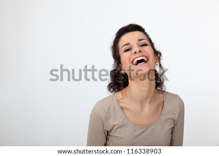 Gorgeous woman laughing out loud