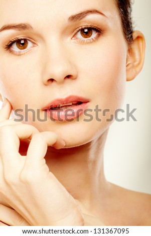 Gorgeous woman looking at camera over white background