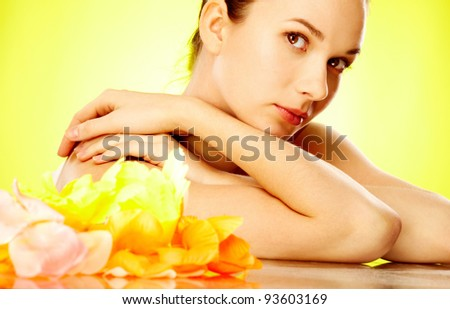 Gorgeous woman looking at camera over yellow background