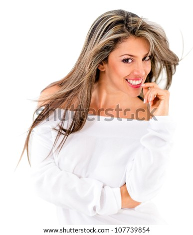 Gorgeous woman smiling and biting her nails - isolated over a white background