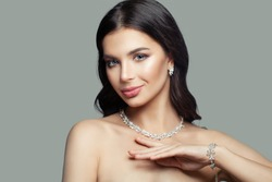 Gorgeous woman with makeup, perfect haircut and diamond necklace, bracelet and earrings, fashion portrait