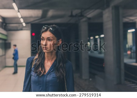 Gorgeous young brunette posing in a metro station #279519314