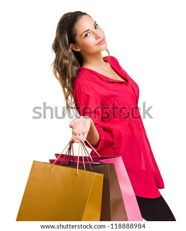 Gorgeous young brunette woman holding colorful shopping bags isolated on white background.