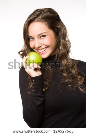 Gorgeous young brunette woman showing off fresh green apple.