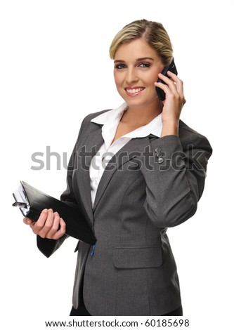 Gorgeous young business woman poses while on the phone