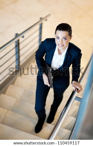gorgeous young businesswoman walking up stairs
