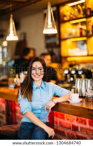 Gorgeous young cheerful woman dressed in stylish clothes sitting in a cafe. Fashion , lifestyle concept #1304684740