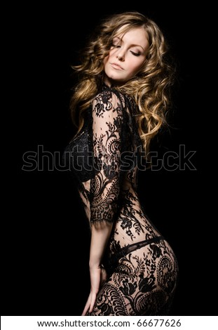 gorgeous young model in lace dress dancing, over black