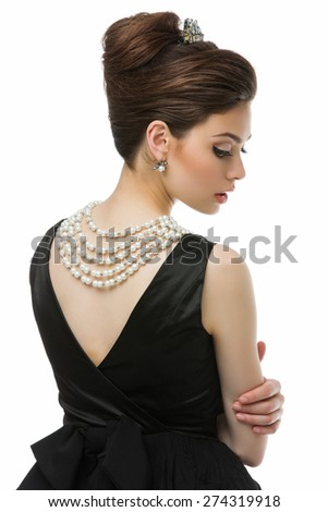 Gorgeous young woman looking like Audrey Hepburn in Breakfast at Tiffany's movie. Isolated over white background