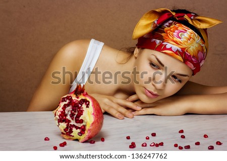 Gorgeous young woman wearing colorful scarf with Pomegranate