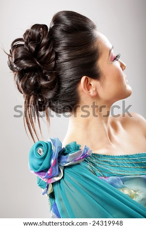 Gorgeously created elegant updo on a brunette model