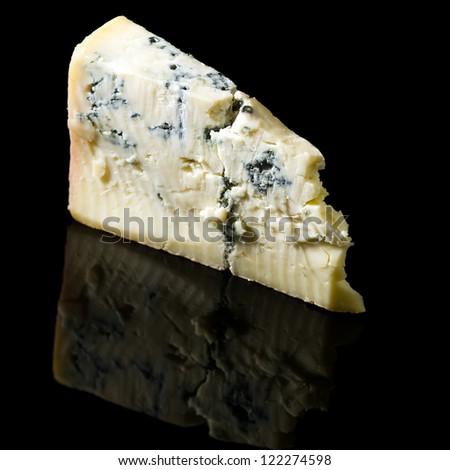 Gorgonzola cheese on black background - stock photo
